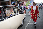 © Joel Goodman - 07973 332324 . 24 August 2013 . Manchester , UK . The Queen with footman . 2013 Gay Pride Parade through Manchester City Centre . This year's theme is 1980s . Photo credit : Joel Goodman