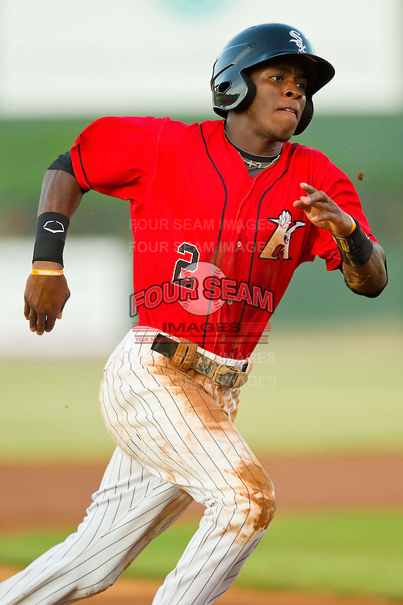 Tim Anderson (2) of the Kannapolis Intimidators hustles towards third base against the Greensboro Grasshoppers at CMC-Northeast Stadium on July 15, 2013 in Kannapolis, North Carolina.  The Intimidators defeated the Grasshoppers 4-0.   (Brian Westerholt/Four Seam Images)