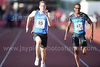 International athletics at Cardiff International stadium, Cardiff, South Wales - Tuesday 15th July 2014<br /> <br /> Richard Tremblen(45) of Cardiff AAC on his way to winning the Men's 100m final 'B'<br /> <br /> Photo by Jeff Thomas Photography