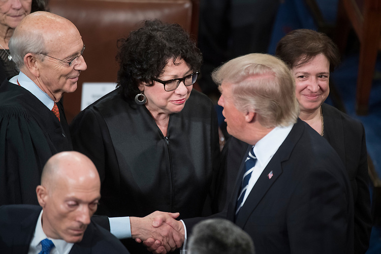 UNITED STATES - FEBRUARY 28: President Donald Trump greets Supreme Court Justices Stephen Breyer, Sonia Sotomayor, center, and Elena Kagan, after addressing a joint session of Congress in the Capitol's House Chamber, February 28, 2017. (Photo By Tom Williams/CQ Roll Call)