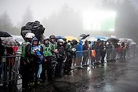 rain soaked photographers waiting for the podium ceremony to start<br /> <br /> torrential rainstorm hits Stage 7: Saint-Genix-les-Villages to Pipay  (133km)<br /> 71st Critérium du Dauphiné 2019 (2.UWT)<br /> <br /> ©kramon