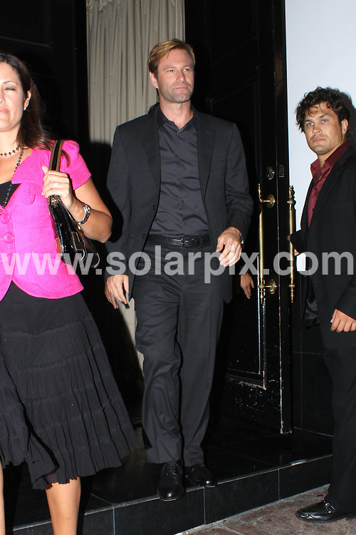 **ALL ROUND PICTURES FROM SOLARPIX.COM**.**WORLDWIDE SYNDICATION RIGHTS**.**NO PUBLICATION IN AUSTRALIA, DENMARK, GERMANY, NEW ZEALAND, OR USA**.Aaron Eckhart enjoys a late night dinner with friends at Beso Restaurant in Hollywood...JOB REF:  7201           LAP/HD       DATE: 04.09.08.**MUST CREDIT SOLARPIX.COM OR DOUBLE FEE WILL BE CHARGED* *UNDER NO CIRCUMSTANCES IS THIS IMAGE TO BE REPRODUCED FOR ANY ONLINE EDITION WITHOUT PRIOR PERMISSION*