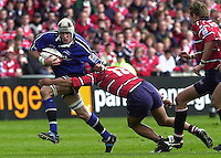 Sport - Rugby 28/04/2002 Parker Pen Shield - Semi-Final.Gloucester vs Sale - Franklin Gardens - Northampton. Shark's flanker, Chris Jones breaks through Terry Fanolue tackle..[Mandatory Credit, Peter Spurier/ Intersport Images].