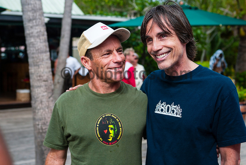 Tavarua Island, Fiji. Surfing legend and two times World Surfing Champion Tom Carroll (AUS) with music legend Jackson Browne (USA). Photo: joliphotos.com