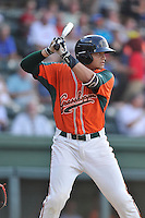 Catcher Roy Morales (17) of the Greensboro Grasshoppers bats in a game against the Greenville Drive on Thursday, July 14, 2016, at Fluor Field at the West End in Greenville, South Carolina. (Tom Priddy/Four Seam Images)