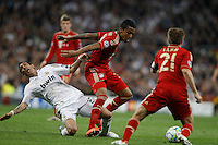 25.04.2012 SPAIN -  UEFA Champions League Semi-Final 2nd leg  match played between Real Madrid CF vs  FC Bayern Munchen 2 (1) - 1 (3) at Santiago Bernabeu stadium. The picture show Angel di Maria (Argentine midfielder of Real Madrid) and  Luiz Gustavo  (Midfielders Bayern Munchen)
