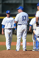 South Dakota State JackRabbits head coach Dave Schrage (13) makes a pitching change during a game against the Georgetown Hoyas at South County Regional Park on March 9, 2014 in Port Charlotte, Florida.  Georgetown defeated South Dakota 7-4.  (Mike Janes/Four Seam Images)
