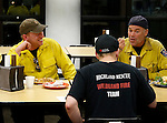 SPEARFISH, SD - JUNE 30, 2016 -- Line EMT Chris Leahy of Evergreen, Colorado right, talks with firefighter Michael Scott, left of the Brookings (SD) Volunteer Fire Department and Aaron Smith, Medical Unit of Golden, Colorado (back to camera) while grabbing a meal after their shift at the Crow Peak Fire Thursday. Crews have been getting meals at the student union on the campus of Black hills State University. Leahy is from Evergreen, CO(Photo by Richard Carlson/dakotapress.org)