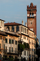 General view of buildings surrounding the Piazza delle Erbe and 14th century Gardello Tower, Verona, Italy. The Gardello Tower was built in 1370 in brick by Cansignorio della Scala. The apex was added in 1626. Picture by Manuel Cohen.