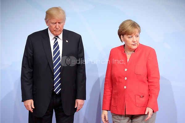 German chancellor Angela Merkel greets the American president Donald Trump at the G20 summit in Hamburg, Germany, 7 July 2017. The heads of the governments of the G20 group of countries are meeting in Hamburg on the 7-8 July 2017. Photo: Michael Kappeler/dpa /MediaPunch ***FOR USA ONLY***