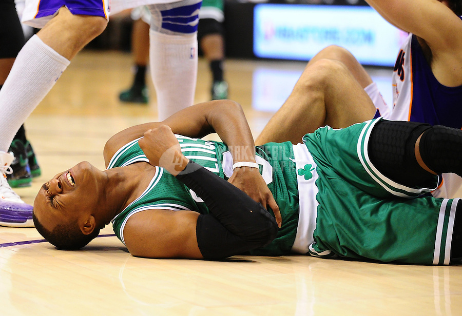Jan. 28, 2011; Phoenix, AZ, USA; Boston Celtics guard Rajon Rondo (9) reacts in pain after falling to the court in the second quarter against the Phoenix Suns at the US Airways Center. Mandatory Credit: Mark J. Rebilas-