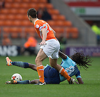 Marcus Bean of Wycombe Wanderers is fouled by Danny Pugh of Blackpool during the Sky Bet League 2 match between Blackpool and Wycombe Wanderers at Bloomfield Road, Blackpool, England on 20 August 2016. Photo by James Williamson / PRiME Media Images.