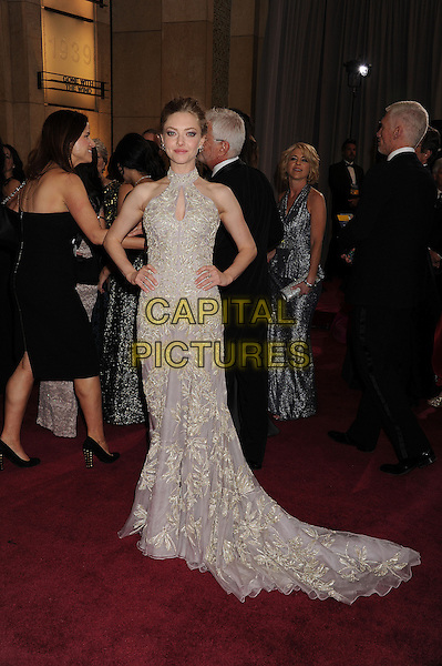 Amanda Seyfried (wearing Alexander McQueen).85th Annual Academy Awards held at the Dolby Theatre at Hollywood & Highland Center, Hollywood, California, USA..February 24th, 2013.oscars full length dress hand on hip embellished high collar keyhole bust cut out lilac purple sheer gold embroidered print sleeveless .CAP/ROT/TM.©Tony Michaels/Roth Stock/Capital Pictures