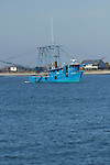 Shrimp boat off folly beach on the Atlantic Ocean South Carolina Blue