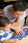 Education Preschool toddler 2s program father reads book to son   at the start of the day