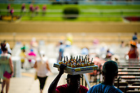 BALTIMORE, MD - MAY 19: A workers looks for customers to sell his alcoholic beverages on Black-Eyed Susan Day at Pimlico Race Course on May 19, 2017 in Baltimore, Maryland.(Photo by Douglas DeFelice/Eclipse Sportswire/Getty Images)