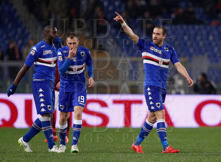 Calcio, Serie A: Roma vs Sampdoria. Roma, stadio Olimpico, 16 marzo 2015. <br /> Sampdoria&rsquo;s Lorenzo De Silvestri, right, celebrates with teammates Vasco Regini, center, and Stefano Okaka, after scoring during the Italian Serie A football match between Roma and Sampdoria at Rome's Olympic stadium, 16 March 2015.<br /> UPDATE IMAGES PRESS/Isabella Bonotto
