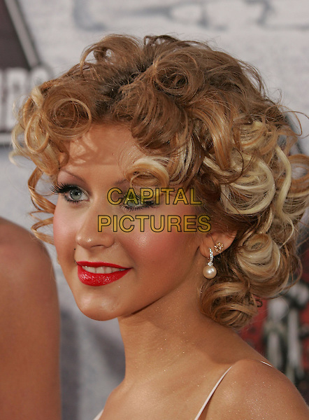 CHRISTINA AGUILERA.at the 2004 MTV Movie Awards held at The Sony Picture Studios in Culver City, .California,.6th June 2004..portrait headshot curly hair.*UK sales only*.www.capitalpictures.com.sales@capitalpictures.com.©Capital Pictures