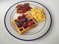 Waffle with blueberry and raspberry compote, scrambled eggs, bacon. One is a series of Blue Plate Special photos. <br /> <br /> instagram.com/theblueplatespecial