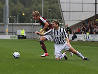 Arvydas Novikovas beats David van Zanten in the St Mirren v Heart of Midlothian Clydesdale Bank Scottish Premier League match played at St Mirren Park, Paisley on 15.9.12.