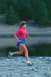 Woman running on the shore at Stampede Reservoir
