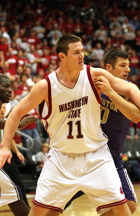 Aron Baynes, Washington State senior center, battles the University of Washington's Jon Brockman for position during the Cougars game against the Huskies in Pullman, Washington, on January 3, 2009.  The Huskies broke a seven game losing streak to the Cougs by prevailing 68-48.
