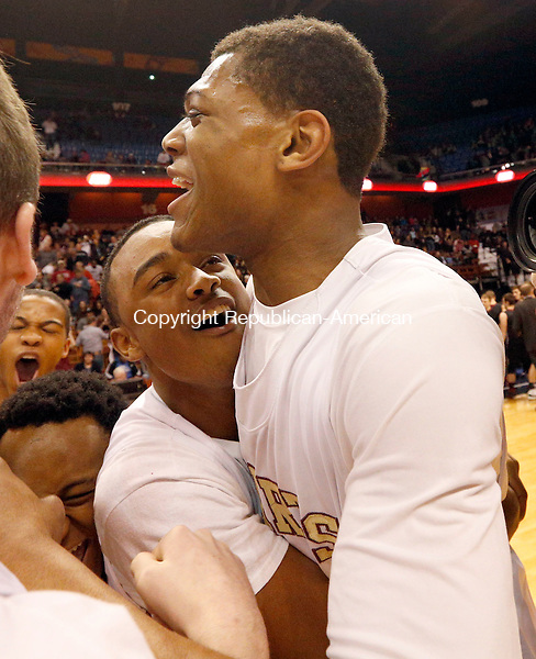 Uncasville, CT- 22 March 2015-032215CM33- Sacred Heart's Isaiah Rascoe, left, and Malik Petteway celebrate celebrates after the Hearts defeated Valley Regional in Class S state championship game at Mohegan Sun Arena in Uncasville on Sunday. The Hearts won, 71-46.    Christopher Massa Republican-American