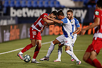 22nd June 2020; Estadio Municipal de Butarque, Madrid, Spain; La Liga Football, Club Deportivo Leganes versus Granada; Antonio Puertas (Granada CF) holds off the challenge with his arms