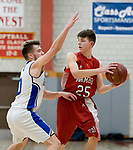 WOLCOTT, CT-031418JS09- Wamogo's Eric Odenwaelder (25) looks to pass while being guarded by East Hampton's Thomas Close during their Division V semifinal game Wednesday at Wolcott High School. <br /> Jim Shannon Republican-American