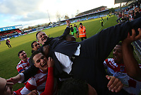 Kingstonian manager Hayden Bird is raised up in front of the fans during Macclesfield Town vs Kingstonian, Emirates FA Cup Football at the Moss Rose Stadium on 10th November 2019