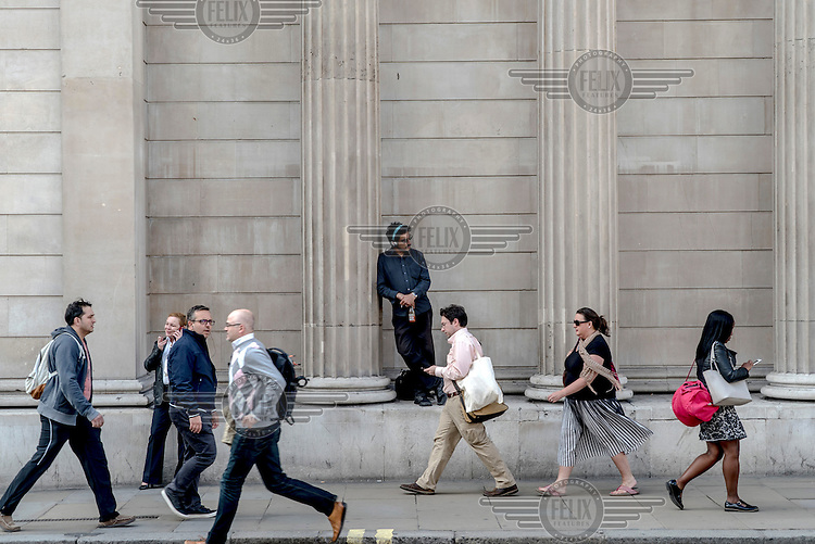 People make their way to work during the rush hour in the City of London on the morning following the EU referendum. The success of the 'leave' (the EU) vote led to immediate financial turmoil as the markets reacted negatively to the result.