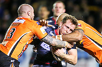 Picture by Alex Whitehead/SWpix.com - 06/03/2015 - Rugby League - First Utility Super League - Castleford Tigers v Wigan Warriors - the Mend A Hose Jungle, Castleford, England - Wigan's Dan Sarginson is tackled by Castleford's Jake Webster and Nathan Massey.