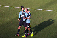 Joe Jacobson of Wycombe Wanderers with goalscorer Michael Harriman of Wycombe Wanderers on the final whistle during the Sky Bet League 2 match between Wycombe Wanderers and Mansfield Town at Adams Park, High Wycombe, England on 25 March 2016. Photo by Andy Rowland.