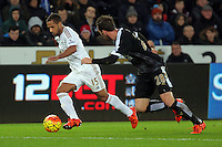 (L-R) Wayne Routledge of Swansea against Christian Fuchs of Leicester City during the Barclays Premier League match between Swansea City and Leicester City at the Liberty Stadium, Swansea on December 05 2015