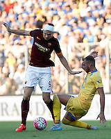 Calcio, Serie A: Frosinone vs Roma. Frosinone, stadio Comunale, 12 settembre 2015.<br /> Roma&rsquo;s Edin Dzeko, left, is challenged by Frosinone&rsquo;s Leonardo Blanchard during the Italian Serie A football match between Frosinone and Roma at Frosinone Comunale stadium, 12 September 2015.<br /> UPDATE IMAGES PRESS/Isabella Bonotto