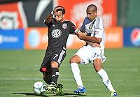 Dwayne De Rosario (7) of D.C. United goes against Leonardo (22) of the Los Angeles Galaxy.  D.C. United tied the Los Angeles Galaxy 2-2, at RFK Stadium, Saturday September 14 , 2013.