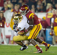 Linebacker Manti Te'o (5) intercepts a pass intended for USC Trojans wide receiver Marqise Lee (9) in the third quarter.