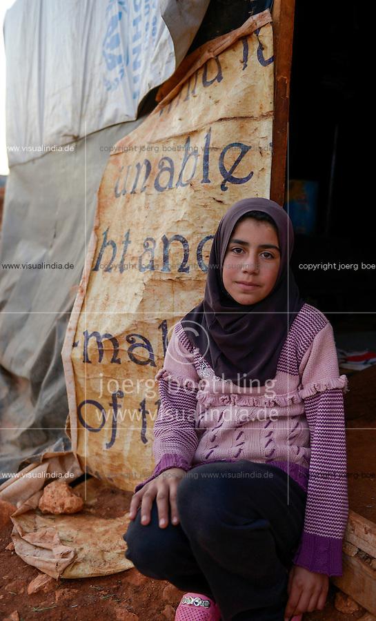LEBANON Deir el Ahmad, a maronite christian village in Beqaa valley, syrian refugee camp / LIBANON Deir el Ahmad, ein christlich maronitisches Dorf in der Bekaa Ebene, Camp fuer syrische Fluechtlinge, Familie Bassimeh Al Rifai, die Tochter Roya Nayef (im Bild) geht zur Schule der Good Shephaerd sisters