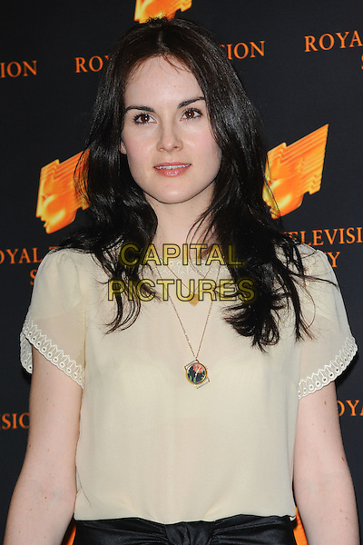 MICHELLE DOCKERY.The Royal Television Society (RTS) Awards, Grosvenor House Hotel, Park Lane, London, England, UK,.March 15th 2011..half length black cream top necklace .CAP/CJ.©Chris Joseph/Capital Pictures.