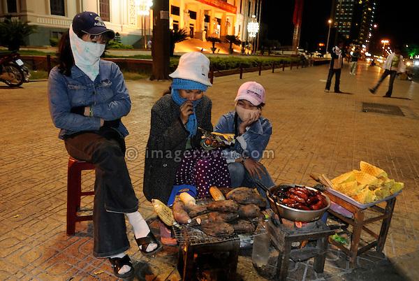 "Asia, Vietnam, Nha Trang. Nha Van Hoa. Street food stall in front of ""Nha Van Hoa"", Nha Trang's Vietnamese Cultural House located at the beach promenade Tran Phu."