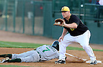 SIOUX FALLS, SD - MAY 20:  Chase Burch #23 from the Sioux Falls Canaries catches the ball as Zac Mitchell #7 from the Gary Southshore Railcats dives back to first in the fifth inning Tuesday evening at the Canaries Stadium.  (Photo by Dave Eggen/Inertia)