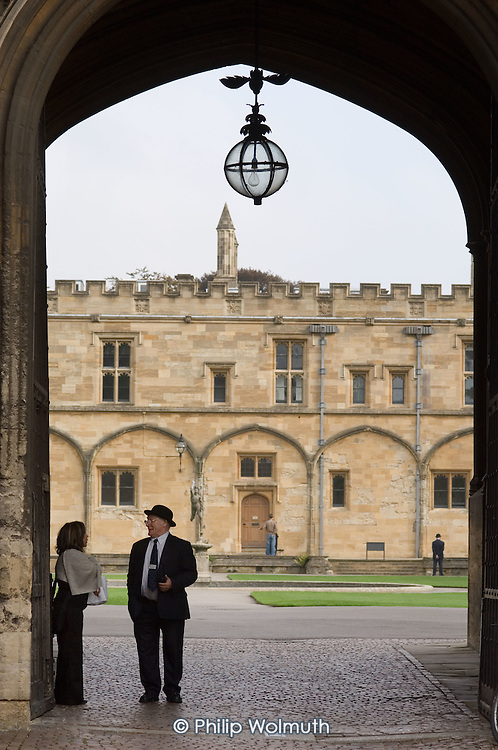 A college porter stands in the entrance to Chirst Church College, Oxford