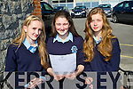 PAPER: Katie Flynn (Cordal), Elizabeth O'Connor (Abbeydorney) and Makayla Donovan (Castleisland) Presentation Secondary School;,Castleisland, looking over their leaving cert results on Wednesday.