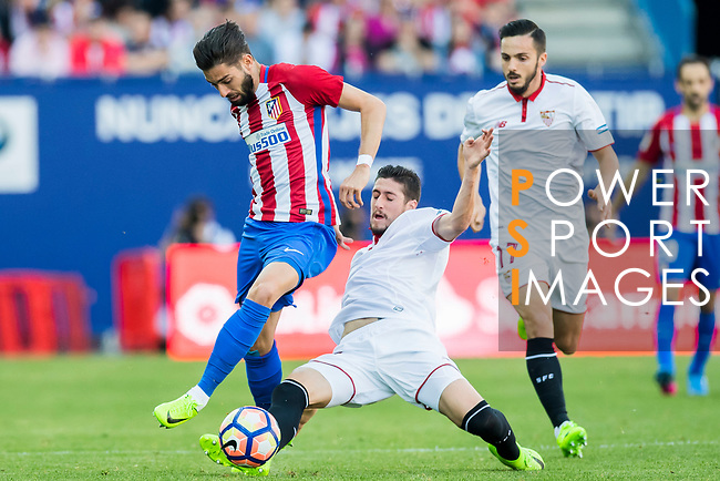 Yannick Ferreira Carrasco (l) of Atletico de Madrid is challenged by Sergio Escudero Palomo (c) of Sevilla FC during their La Liga match between Atletico de Madrid and Sevilla FC at the Estadio Vicente Calderon on 19 March 2017 in Madrid, Spain. Photo by Diego Gonzalez Souto / Power Sport Images