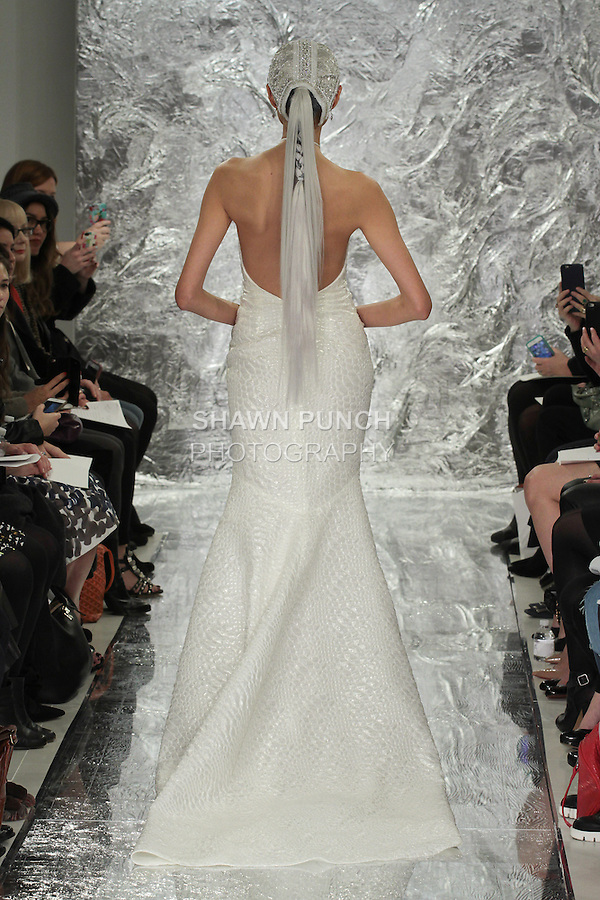 Model Shin Yang walks runway in Ripley - an opalescent reptilitan silk jacquard halter bridal gown, from the Theia Spring 2017 bridal collection by Don O'Neill, during New York Bridal Fashion Week Spring Summer 2017 on April 14, 2016.