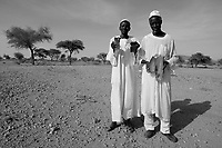 Normi, North Darfur, August 24, 2004.Two villagers, showing fragments of bombs launched on their village on July 15, 2003 by Sudan Air Force Antonov planes and MI24 helicopter gunships during a coordinated attack by a janjaweed militia.