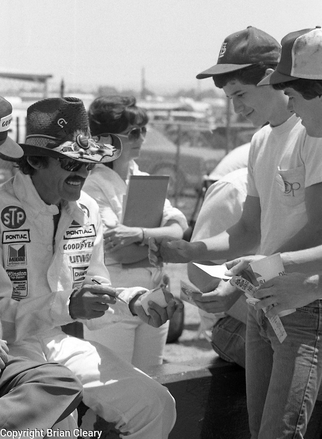 Richard Petty autographs fans Winston 500 at Alabama International Motor Speedway in Talladega , AL on May 5, 1985. (Photo by Brian Cleary/www.bcpix.com)
