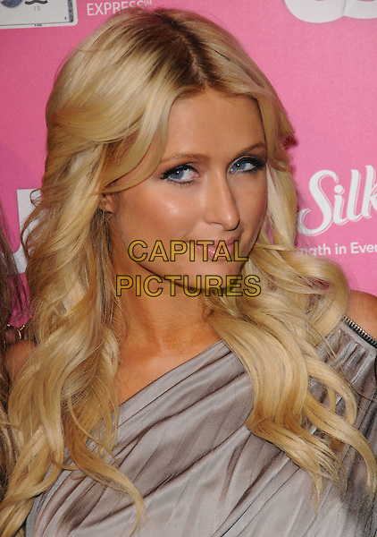 PARIS HILTON.The Annual US Weekly Hot Hollywood Event held at The Colony in Hollywood, California, USA..November 18th, 2010.headshot portrait grey gray one shoulder make-up beauty .CAP/RKE/DVS.©DVS/RockinExposures/Capital Pictures.
