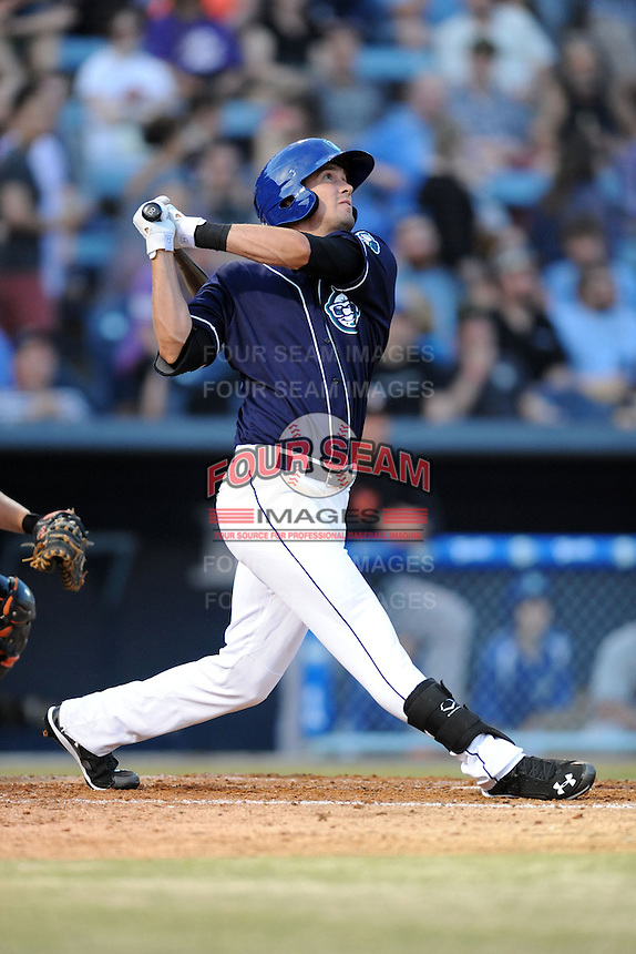 Asheville Tourists center fielder David Dahl #21 swings at a pitch during opening night game against the Delmarva Shorebirds at McCormick Field on April 3, 2014 in Asheville, North Carolina. The Tourists defeated the Shorebirds 8-3. (Tony Farlow/Four Seam Images)