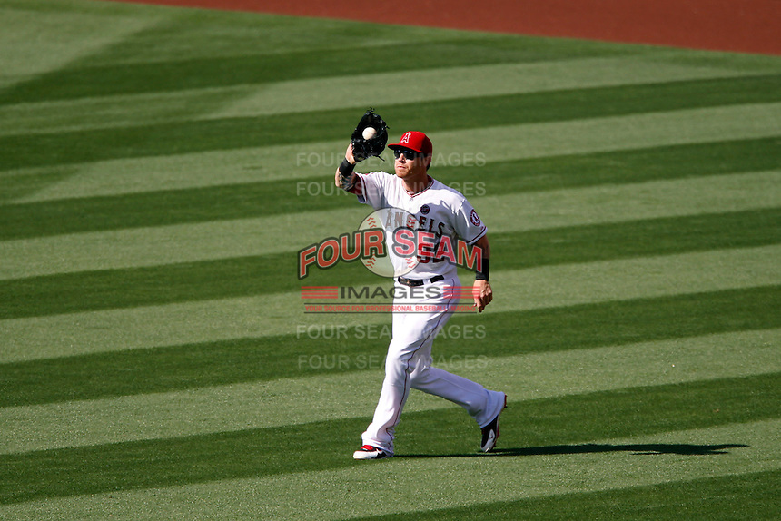 Josh Hamilton #32 of the Los Angeles Angels catches a fly ball during a game against the New York Yankees at Angel Stadium on June 15, 2013 in Anaheim, California. (Larry Goren/Four Seam Images)
